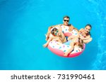 happy family with inflatable... | Shutterstock . vector #731990461