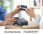 young woman paying with credit... | Shutterstock . vector #732005497
