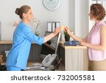 young female receptionist with... | Shutterstock . vector #732005581