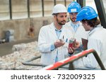 Small photo of man showing objects to colleague with accusatory expression