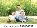 father with children in park on ... | Shutterstock . vector #732034357