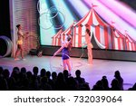 girls juggling with rings.... | Shutterstock . vector #732039064