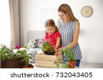 cute little girl with mother... | Shutterstock . vector #732043405