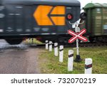 Small photo of Railroad crossing with passing goods train.