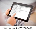 person reading e mail on tablet.... | Shutterstock . vector #732083401