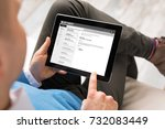 man reading email on tablet.... | Shutterstock . vector #732083449