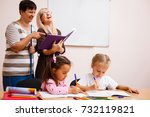 two teachers in class with... | Shutterstock . vector #732119821