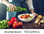 the chef in black apron makes a ...   Shutterstock . vector #732124411