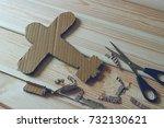 a cardboard plane and scissors... | Shutterstock . vector #732130621