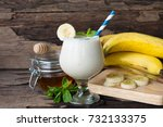 banana smoothies on old wooden... | Shutterstock . vector #732133375