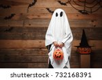 Stock photo halloween concept little white ghost with halloween pumpkin candy jar doing trick or treat with 732168391
