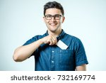 young man who takes out blank... | Shutterstock . vector #732169774