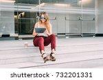 beautiful young woman sitting... | Shutterstock . vector #732201331