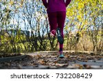 Small photo of Unknown adult running outside.