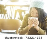 woman holding a glass of warm... | Shutterstock . vector #732214135