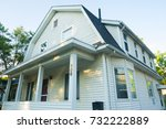 Small photo of Michigan, United States - July 11, 2017: Exterior view of a white timber house in a quiet suburban street in Ann Abor