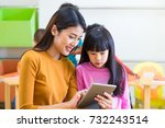 asia woman teacher teach girl... | Shutterstock . vector #732243514