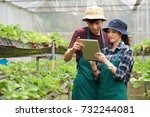 young asian scientists wearing... | Shutterstock . vector #732244081