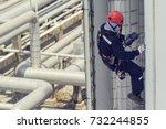male worker rope access ... | Shutterstock . vector #732244855