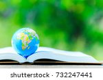 the globe placed on the book...   Shutterstock . vector #732247441