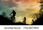 couple cycling outdoor at sunset | Shutterstock . vector #732287404