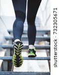 medium shot of a woman jogging... | Shutterstock . vector #732305671