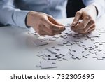 female hands holding a jigsaw... | Shutterstock . vector #732305695