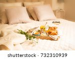 continental breakfast on bed in ... | Shutterstock . vector #732310939