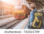young traveler man standing at... | Shutterstock . vector #732321709