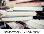 books  on the piano keyboard  | Shutterstock . vector #732327049