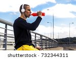 young man drinking energy drink.... | Shutterstock . vector #732344311