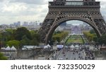 Small photo of Crowded place near the Eiffel tower base and Champ de Mars in Paris, France