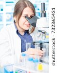 young woman lab assistant in a... | Shutterstock . vector #732365431