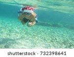 boy in santa claus hat swimming ... | Shutterstock . vector #732398641
