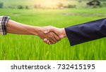 close up hands of farmer and... | Shutterstock . vector #732415195