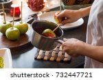 girl preparing apples on a... | Shutterstock . vector #732447721