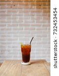 a glass of lemon iced tea on... | Shutterstock . vector #732453454