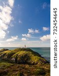 Small photo of Stumble head and lighthouse on a sunny day. Pencaer, Pembrokeshire, Wales, United Kingdom.