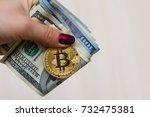 golden bitcoin coin on women's... | Shutterstock . vector #732475381