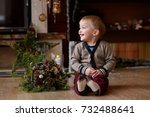 little child near the fireplace ... | Shutterstock . vector #732488641