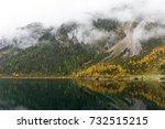 mountain lake in austrian alps. | Shutterstock . vector #732515215