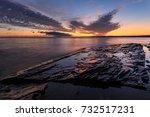 a dramatic sunrise over lake... | Shutterstock . vector #732517231