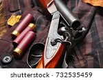 Small photo of Hunting double barrel vintage shotgun, cartridge case on the on the hunters jacket in cell, close-up.Copy space.Concept hunting.Englsih hunter concept.Autumn
