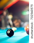 Small photo of Pool ball on a pool table