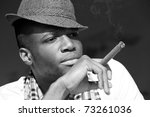 Black Man Smoking Cigar...