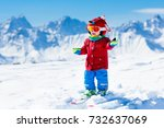 child skiing in the mountains.... | Shutterstock . vector #732637069