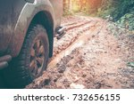 car wheel on a dirt road. off... | Shutterstock . vector #732656155