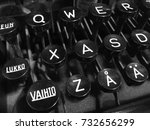 "Small photo of Finnish vintage typewriter including uppercase ""Vaihto"" (Shift), ""Lukko"" (Caps Lock), letter A with ring, letter A with diaeresis, and QWERTY keys."