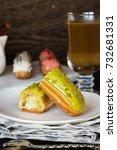 Small photo of Pistachio, vanilla, strawberry eclair in glaze