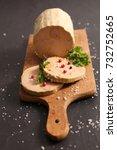 Small photo of foie gras on board